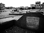 """Those who live among the Dead The City of the Dead is the monumental cemetery of  Cairo currently inhabited by almost 800,000 people who have occupied the funery chappels were the dead are burried, making them their permanent homes. <br /> <br /> Although ranking 18th position in the list of the  largest slums in the world  ( of wich as many as four  are in Cairo).<br /> <br /> What is amazing there, is the overlapping of concept such as life and death, old and new. People live among the tombs and kids play on them. But always with a total respect for those buried underground. In 90% of the cases, the buried ones do not belong to the family living """"upstairs"""". But they care about them like they were their beloved departed ones."""