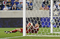 Houston Dynamo goalkeeper Pat Onstad (18) lays on the turf as the ball crosses the goal line for the winning goal in second half stoppage time. The New York Red Bulls defeated the Houston Dynamo 2-1 during a Major League Soccer (MLS) match at Red Bull Arena in Harrison, NJ, on June 2, 2010.