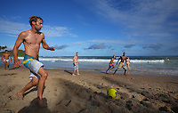 People play football at Farol da Barra beach in Salvador, Brazil, one of the 12 host cities of the 2014 FIFA World Cup