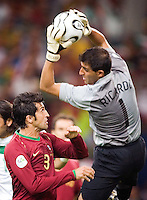 Portugal goalkeeper Ricardo (1) makes a save over the head of teammate Caneira (3). Portugal defeated Mexico 2-1 in their FIFA World Cup Group D match at FIFA World Cup Stadium, Gelsenkirchen, Germany, June 21, 2006.
