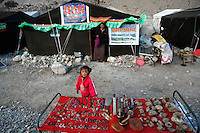 "A tent owner and her daughter stands in front his tent guest house at the tent village near Everest base camp.<br /> China started building a controversial 67-mile ""paved highway fenced with undulating guardrails"" to Mount Qomolangma, known in the west as Mount Everest, to help facilitate next year's Olympic Games torch relay."