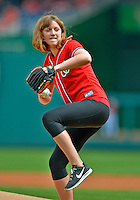 3 September 2012: Olympic Gold Medalist Katie Ledecky winds up to throw out the Ceremonial First Pitch prior to a game between the Washington Nationals and the Chicago Cubs at Nationals Park in Washington, DC. The Nationals edged out the visiting Cubs 2-1, in the first game of heir 4-game series. Mandatory Credit: Ed Wolfstein Photo