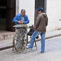 Cuba, Havana.  Street Scene, Old Havana, Knife Sharpener.