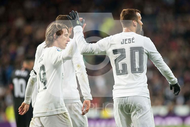 Real Madrid's Luka Modric and Jese Rodriguez celebrating a goal during La Liga match. March 20,2016. (ALTERPHOTOS/Borja B.Hojas)