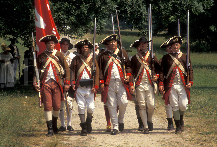 "AJ2775, Valley Forge Park, soldiers, reenactment, Valley Forge, Pennsylvania, Men dressed in Continental Army soldier costumes march together in formation at the reenactment of the American Revolution at the """"March out of the Continental Army"""" in Valley Forge National Historical Park in Valley Forge in the state of Pennsylvania."