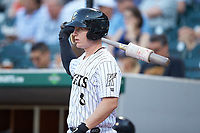 Zack Collins (8) of the Charlotte Knights waits for his turn to bat during the game against the Toledo Mud Hens at BB&T BallPark on April 24, 2019 in Charlotte, North Carolina. The Knights defeated the Mud Hens 9-6. (Brian Westerholt/Four Seam Images)