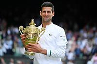 11th July 2021, Wimbledon SW London England, AELTC Wimbledon Tennis Championships, mens final, Novak Djokovic (Ser)  versus Matteo Berrettini (Ita) Novak Djokovic (Ser) celebrates his win in 4 sets with the trophy