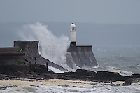 Wednesday  29 June 2016<br /> Pictured: Huge waves batter the harbour wall and lighthouse in Porthcawl, South Wales <br /> Re: Rain and wind continues to batter parts of the UK