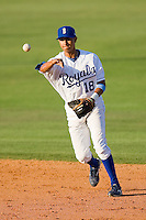 Second baseman Adrian Martinez #18 of the Burlington Royals makes a throw to first base against the Kernersville Bulldogs in an exhibition game at Burlington Athletic Stadium June20, 2010, in Burlington, North Carolina.  Photo by Brian Westerholt / Four Seam Images