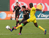 San Francisco, California - Saturday March 17, 2012: Hector Herrera and Ibrahima Yigo Ba in action during the Mexico vs Senegal U23 in final Olympic qualifying tuneup. Mexico defeated Senegal 2-1
