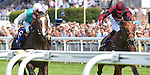 Snow Sky (no. 6), ridden by James Doyle and trained by Michael Stoute, wins the group 3 Gordon Stakes on July 30, 2014 at Goodwood Racecourse in Chichester, West Sussex, England.  (Bob Mayberger/Eclipse Sportswire)