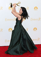 LOS ANGELES, CA, USA - AUGUST 25: Writer-Comedian Sarah Silverman, winner of the Outstanding Writing for a Variety Special Award for 'Sarah Silverman: We Are Miracles', poses in the press room at the 66th Annual Primetime Emmy Awards held at Nokia Theatre L.A. Live on August 25, 2014 in Los Angeles, California, United States. (Photo by Celebrity Monitor)