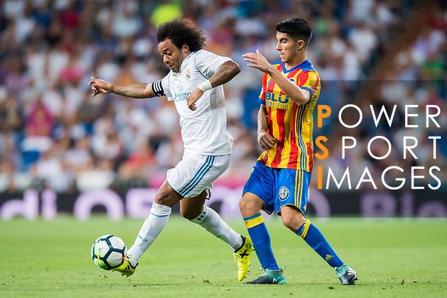 Marcelo Vieira Da Silva (l) of Real Madrid fights for the ball with Carlos Soler Barragan of Valencia CF during their La Liga 2017-18 match between Real Madrid and Valencia CF at the Estadio Santiago Bernabeu on 27 August 2017 in Madrid, Spain. Photo by Diego Gonzalez / Power Sport Images