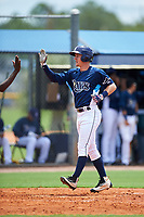GCL Rays right fielder Jake Stone (8) is congratulated as he crosses home plate after hitting a home run in the top of the fifth inning during the first game of a doubleheader against the GCL Twins on July 18, 2017 at Charlotte Sports Park in Port Charlotte, Florida.  GCL Twins defeated the GCL Rays 11-5 in a continuation of a game that was suspended on July 17th at CenturyLink Sports Complex in Fort Myers, Florida due to inclement weather.  (Mike Janes/Four Seam Images)
