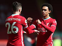24th April 2021; Anfield, Liverpool, Merseyside, England; English Premier League Football, Liverpool versus Newcastle United; full backs Andy Robertson of Liverpool and Trent Alexander-Arnold of Liverpool fist bump prior to the kick off