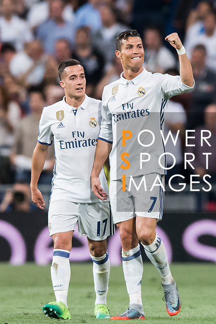 Cristiano Ronaldo of Real Madrid celebrates with teammate Lucas Vazquez during their 2016-17 UEFA Champions League Quarter-finals second leg match between Real Madrid and FC Bayern Munich at the Estadio Santiago Bernabeu on 18 April 2017 in Madrid, Spain. Photo by Diego Gonzalez Souto / Power Sport Images