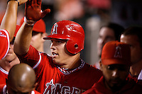 Mike Trout #27 of the Los Angeles Angels is greeted by his teammates during a game against the Oakland Athletics at Angel Stadium on September 10, 2012 in Anaheim, California. Oakland defeated Los Angeles 3-1. (Larry Goren/Four Seam Images)
