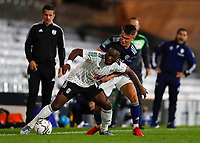 21st September 2021; Craven Cottage, Fulham, London, England; EFL Cup Football Fulham versus Leeds; Neeskens Kebano of Fulham is challenged by Jamie Shackleton of Leeds United