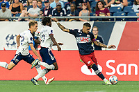 FOXBOROUGH, MA - AUGUST 18: Gustavo Bou #7 of New England Revolution crosses the ball as Chris Odoi-Atsem #3 of D.C. United closes during a game between D.C. United and New England Revolution at Gillette Stadium on August 18, 2021 in Foxborough, Massachusetts.