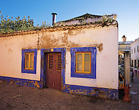 Traditional painted stone house in the old town of Faro, Algarve, Portuga