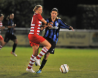 20131001 - VARSENARE , BELGIUM :  Brugge's Nicky Van Den Abbeele (right) pictured with Antwerp Sophie Mannaert (left) during the female soccer match between Club Brugge Vrouwen and Royal Antwerp FC Ladies , of the fifth matchday in the BENELEAGUE competition. Tuesday 1 October 2013. PHOTO DAVID CATRY
