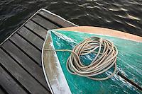 Detail of boat resting upside down on dock at dusk. Westport River, Westport, Massachusetts.