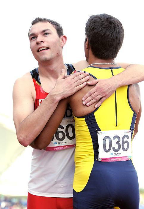 Kyle Whitehouse, Guadalajara 2011 - Para Athletics // Para-athlétisme.<br /> Kyle Whitehouse competing in the Men's 200m - T38 Final // Kyle Whitehouse participant à la finale du 200 m hommes - T38. 11/17/2011.