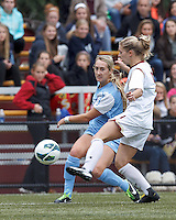 University of North Carolina forward Summer Green (6) centers the ball.   University of North Carolina (blue) defeated Boston College (white), 1-0, at Newton Campus Field, on October 13, 2013.