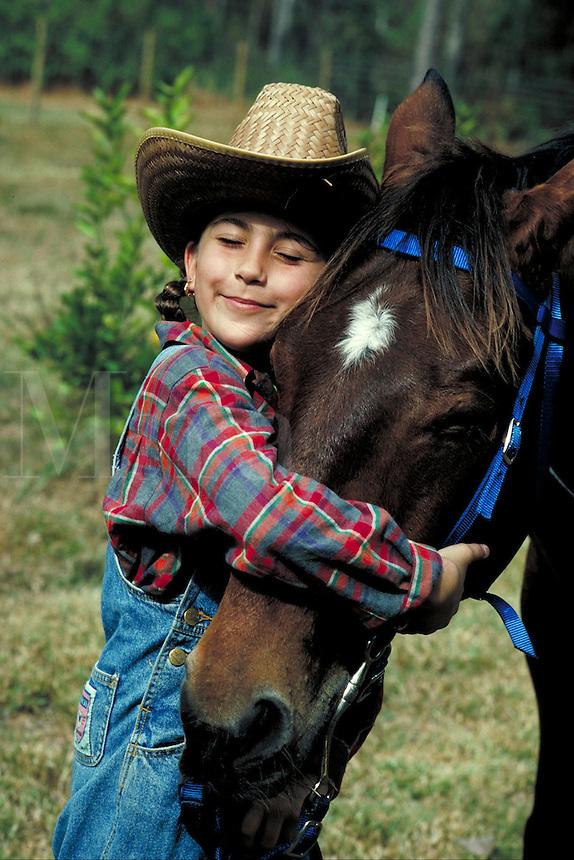 Equestrian 3 Young girl hugging her horse. Little girl. Douglaston NY.