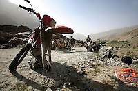 day 3, we spend 2 hours fixing the front wheel on jeromes bike with our eyes out for any unwanted visitors. What do war correspondences do on the holidays. 4 Kabul based journalists were the first westerners to ride motorcycles into the Wakhan corridor.the 12 day trip was full with dramas, breakdowns, arrests, crashes, yak riding and many miles. over 1200 kms they travelled and reached their desired destination of surhad e brogil deep in the wakhan corridor. location of the great game and once named the roof of the world.