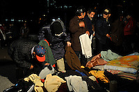 Homeless collect blankets in Shinjuku Park, central Tokyo  15 February 2009.   The numbers of homeless has sky-rocketed in recent months.  According charity groups who distribute food and blankets numbers have increased by 80% in many central Tokyo parks as people have lost hundreds of thousands of jobs since the financial crisis that started in earnest year in November 2008.