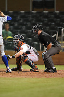 Salt River Rafters catcher Tyler Heineman (17) and umpire Tom Honec during an Arizona Fall League game against the Peoria Javelinas on October 17, 2014 at Salt River Fields at Talking Stick in Scottsdale, Arizona.  The game ended in a 3-3 tie.  (Mike Janes/Four Seam Images)