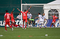 Panamanian players celebrate the game tying goal as Miguel Montes (1) of El Salvador tries to save the ball from crossing the line during the game at RFK Stadium in Washington, DC.  Panama defeated El Salvador on penalty kicks, 5-3, after tying, 1-1,  in regulation time.