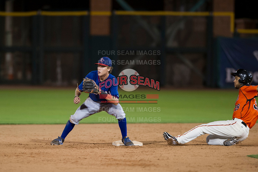 AZL Rangers second baseman Myles McKisic (9) prepares to catch a ball ahead of Aaron Bond (38) during a game against the AZL Giants on September 4, 2017 at Scottsdale Stadium in Scottsdale, Arizona. AZL Giants defeated the AZL Rangers 6-5 to advance to the Arizona League Championship Series. (Zachary Lucy/Four Seam Images)