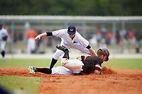 Western Connecticut Colonials shortstop EJ Lavoie (10) tags Jonathan Roehler (9) sliding into second base during the first game of a doubleheader against the Edgewood College Eagles on March 13, 2017 at the Lee County Player Development Complex in Fort Myers, Florida.  Edgewood defeated Western Connecticut 3-0.  (Mike Janes/Four Seam Images)