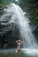 Young woman playing in watefall pool, Chiriqui Viejo River, Panama