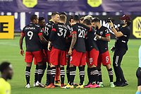 NASHVILLE, TN - SEPTEMBER 23: DC United's starters huddle on the field before a game between D.C. United and Nashville SC at Nissan Stadium on September 23, 2020 in Nashville, Tennessee.