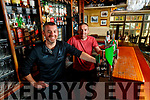 Johnny and Patrick McCarthy behind the bar of Jack Mac's pub in Ashe Street on Wednesday.