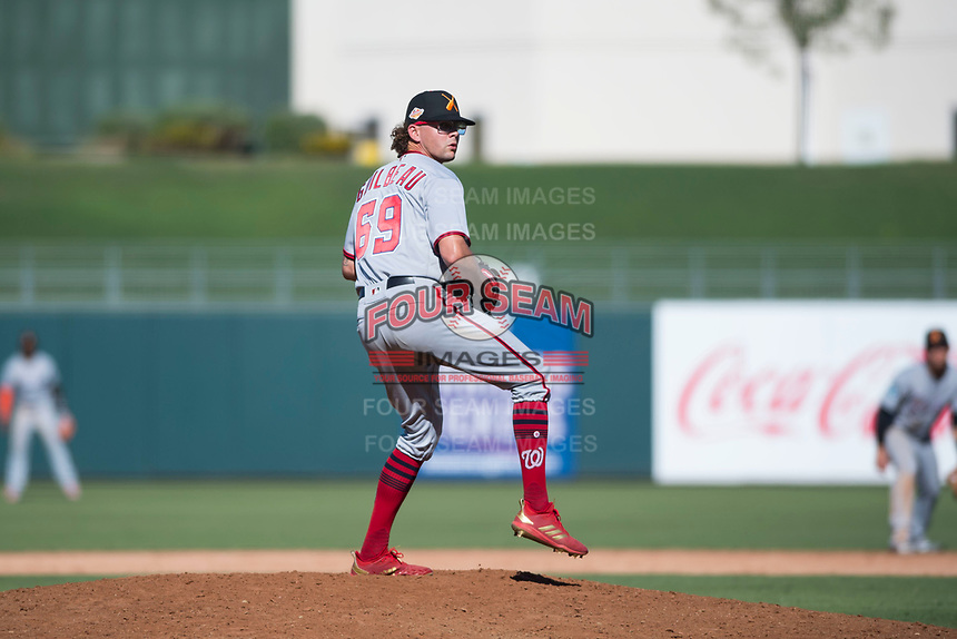 Salt River Rafters relief pitcher Taylor Guilbeau (69), of the Washington Nationals organization, delivers a pitch during an Arizona Fall League game against the Surprise Saguaros on October 9, 2018 at Surprise Stadium in Surprise, Arizona. The Rafters defeated the Saguaros 10-8. (Zachary Lucy/Four Seam Images)