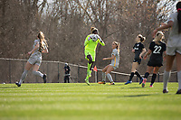 LOUISVILLE, KY - MARCH 13: Kayza Massey #00 of West Virginia University saves a shot at goal during a game between West Virginia University and Racing Louisville FC at Thurman Hutchins Park on March 13, 2021 in Louisville, Kentucky.