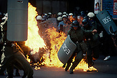 """Seoul, South Korea<br /> June 26, 1988<br /> <br /> Riot police battled anti-government student demonstrators using molotov cocktails.<br /> <br /> After two decades of building an economic miracle, in the summer of 1987 tens of thousands of frustrated South Korean students took to the streets demanding democratic reform. """"People Power"""" Korean-style saw Koreans from all social spectrums join in the protests...With the Olympics to be held in South Korea in 1988, President Chun Doo Hwan decided on no political reforms and to choose the ruling party chairman, Roh Tae Woo, as his heir. The protests multiplied and after 3 weeks Chun conceded releasing oppositionist Kim Dae Jung from his 55th house arrest and shaking hands with opposition leader Kim Young Sam. Days later he endorsed presidential elections and an amnesty for nearly 3,000 political prisoners. It marked the first genuine initiative of democratic reform in South Korea and the people had their victory."""