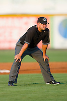 Umpire Jeremy Riggs handles the calls on the bases during an Appalachian League game between the Greeneville Astros and the Burlington Royals at Burlington Athletic Stadium June22, 2010, in Burlington, North Carolina.  Photo by Brian Westerholt / Four Seam Images