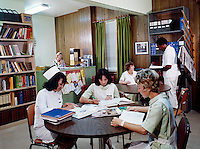 Greenville Memorial Hospital. Nurses reading and studying in the library.