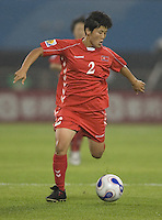 Kim Kyong Hwa of North Korea. The United States (USA) and North Korea (PRK) played to a 2-2 tie during a FIFA Women's World Cup China 2007 opening round Group B match at Chengdu Sports Center Stadium, Chengdu, China, on September 11, 2007.