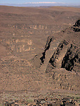 A dry desert gorge near the Tizi n Tinififft Pass in the Jebel Sarhro range of mountains which is part  of the Atlas mountains in Morocco.
