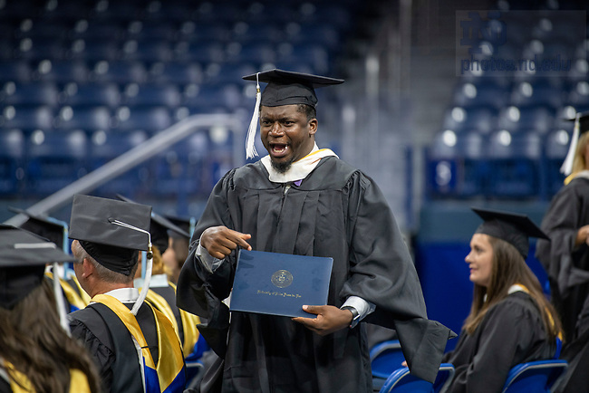 July 10, 2021; 2021 A graduate celebrates after receiving his diploma during the Commencement Ceremony of the University of Notre Dame's Alliance for Catholic Education (ACE) in the Purcell Pavilion of the Joyce Center. (Photo by Barbara Johnston/University of Notre Dame)