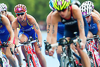 04 AUG 2012 - LONDON, GBR -  Lisa Norden (SWE) of Sweden (left) cycles in the pack during the women's London 2012 Olympic Games Triathlon in Hyde Park, London, Great Britain .(PHOTO (C) 2012 NIGEL FARROW)