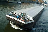 Barge travelling down the Seine, Paris, France.