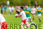 An Ghaeltacht's Brian Ó Beaglaoich gets past John Mitchels Michael Wrenn in the Intermediate Football Championship.