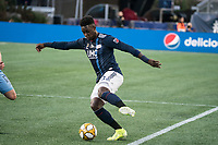 FOXBOROUGH, MA - SEPTEMBER 29: Jalil Anibaba #3 of New England Revolution dribbles down the wing during a game between New York City FC and New England Revolution at Gillettes Stadium on September 29, 2019 in Foxborough, Massachusetts.